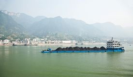 picture of barge  - Coal barge sailing along the Three gorges region of Yangtze river in China - JPG