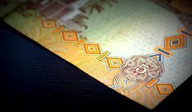 stock photo of dirham  - Banknote of the United Arab Emirates in five dirhams close up - JPG