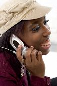 picture of eye brow ring  - young woman talking on her cellphone - JPG