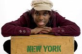 foto of eye brow ring  - hip young black woman leaning on a box that says new york - JPG