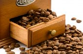 foto of wooden box from coffee mill  - wooden coffee grinder drawer with beans on white - JPG