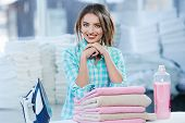 Girl Leaning On Heap Of Rose Towels poster