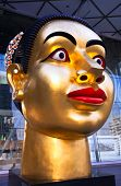BANGKOK - NOVEMBER 25:Sculpture of Indian woman's head, dedicated to the 80th Birthday of His Majest