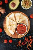 Mexican quesadillas, cheese filled tortilla wraps with salsa and guacamole poster