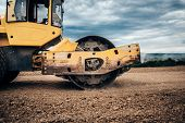 Close Up Details Of Industrial Road Soil Compactor, Vibratory Roller And Heavy Duty Machinery During poster