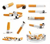 Collage of cigarette butts on white background poster
