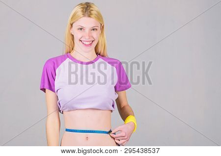poster of Weight Loss. Fitness And Health. Female Slim Waist Belly And Tape Measure. Athlete Fitness Coach Tra
