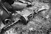World War Ii Soviet Red Army Weapon. Submachine Gun Ppsh On Ground. Wwii Ww2 Russian Ammunition. Pho poster
