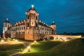 Mir, Belarus. Castle Complex Mir In Evening Or Night Illumination. Cultural Monument, Unesco World H poster