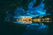 Mir, Belarus. Night Scenic View Of Mir Castle In Evening Illumination With Glow Reflections On Lake  poster