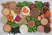 Health food high in protein with meat, fish, dairy, legumes, vegetables, dried fruit, grains, supple poster