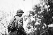 Close Up Single Re-enactor Dressed As German Wehrmacht Infantry Soldier In World War Ii Walking In P poster