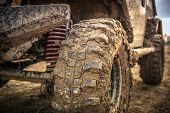 Off Roader Tire Closeup. Suv Wheel Covered By Clay And Mud. Motorsport Theme. poster