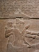 stock photo of babylonia  - Ancient Assyrian wall carvings of men with cuneiform writing