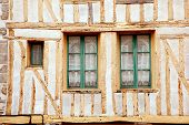 stock photo of corbel  - Windows of medieval timberframe house in historic Dinan - JPG