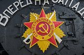 On Front Side Of Old Steam Locomotive Attached Soviet Order Of Patriotic War. Inscription Reads - Pa poster
