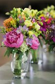 stock photo of flower vase  - wedding bouquets of colorful flowers in vases decorate a tabletop