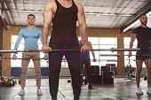Group Of Sporty Athletic Men Training With Barbells. Cross Fit Training. Handsome Men During Workout poster