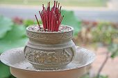Chinese Red Incense Sticks And Metal Holder poster