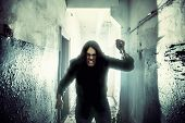 Crazy Criminal Killer Or Robber Or Rapist With Knife In Hand In Dark Scary Corridor, Horror And Thri poster