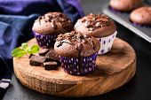 Chocolate Muffins On Wooden Serving Board. Homemade Chocolate Cakes poster