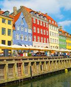 Old Town With Nyhavn Harbor View In Bright Sunny Day, Tourists Walking And Sitting In Bars, Cafes, R poster