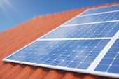3d Illustration Solar Panels On A Red Roof Of A House. Solar Panels With Reflection Beautiful Blue S poster