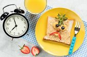 Kids Breakfast Meal, Peanut Butter Toast With Funny Face Of Angry Bird Or Angry Pirate On A Trendy Y poster