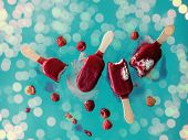 Raspberries Ice Lolly In Air On Blue Background. Object Without Shadows poster