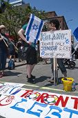 Jewish Reverlers Hold Up Placards In Support Of Gay Rights At The Toronto Gay Pride Festival