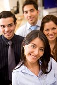 image of business-office  - business team in an office smiling and looking happy - JPG