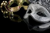 picture of masquerade mask  - Carnival masks and christmas decoration on a black background - JPG