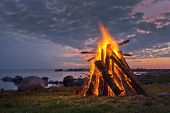 stock photo of bonfire  - Bonfire on the coast in a white Nordic summer night - JPG