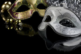 pic of masquerade mask  - Carnival masks and christmas decoration on a black background - JPG