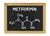 chemical formula of metformin on a blackboard