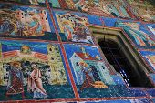 Painted wall at Arbore monastery, Bucovina, Romania