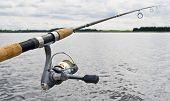 picture of rod  - Fishing reel on rod close up view - JPG