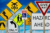 pic of road sign  - Multiple road signs against a blue cloudy sky - JPG