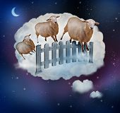 stock photo of counting sheep  - Counting sheep concept as a symbol of insomnia and lack of sleep due to challenges in falling asleep as a group of farm animals jumping over a fence in a dream bubble as an icon of bedtime for sleepy children and tired adults - JPG