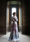 picture of manor  - young beautiful woman in pink dress posing in luxury palace - JPG