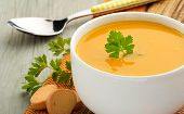 image of butternut  - bowl of soup parsley and croutons on wooden table - JPG
