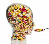 picture of placebo  - a head made of glass filled with many tablets - JPG