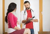 image of gynecological exam  - Young pregnant woman with doctor in hospital - JPG