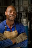 stock photo of factory-worker  - South African or American welder worker in factory - JPG