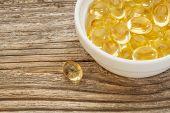 stock photo of ceramic bowl  - fish oil capsules  - JPG