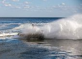 image of waverunner  - strong man drive on the jetski above the water - JPG