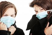 image of swine flu  - A glamorous models wearing a mask to prevent  - JPG