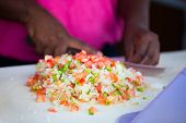 picture of conch  - Close up of Bahamian woman making traditional conch salad - JPG