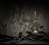 stock photo of mantle  - Scales and wooden hammer on judge - JPG
