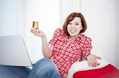 picture of overspending  - red haired student business woman wearing a red shirt worried after online shopping on white background - JPG